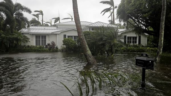 A houses is surrounded by water as Hurricane Irma passes through Naples, Fla., Sunday, Sept. 10, 2017. (AP Photo/David Goldman)