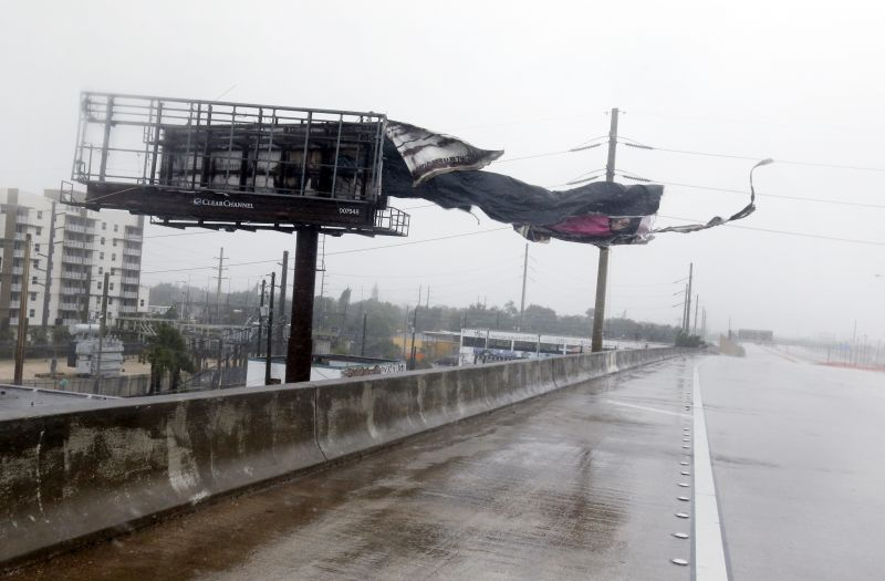 A billboard is ripped apart by high winds along Interstate 95 Northbound as Hurricane Irma passes