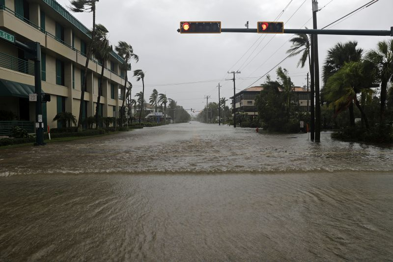 Water floods a street in the business district as Hurricane Irma passes through Naples, Fla.