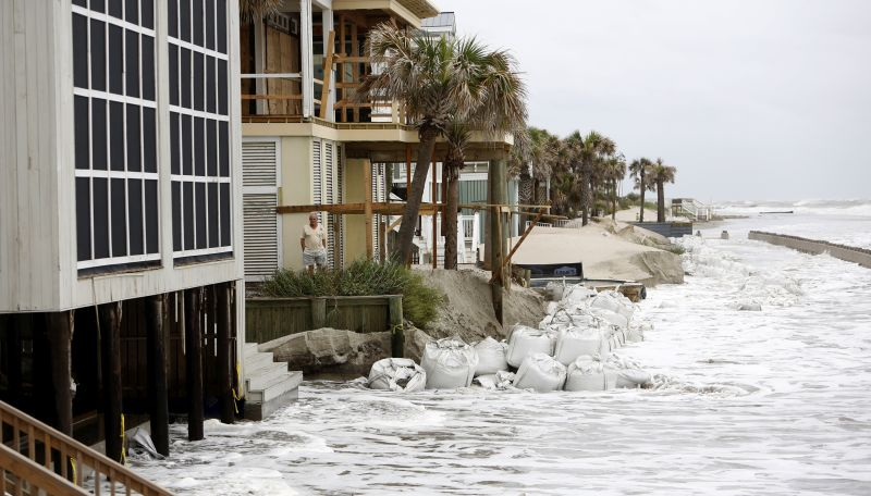 A man looks over the pounding surf caused by Hurricane Irma in the Wild Dunes Resort community of the Isle of Palms, S.C.
