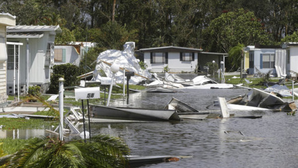 Debris from destroyed mobile site in the Naples Estates mobile home park in the aftermath of Hurricane Irma in Naples, Fla., Monday, Sept. 11, 2017. (AP Photo/Gerald Herbert)