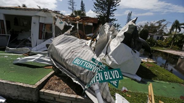 Damaged street signs sit among debris in the Naples Estates mobile home park in the aftermath of Hurricane Irma in Naples, Fla., Monday, Sept. 11, 2017. (AP Photo/Gerald Herbert)