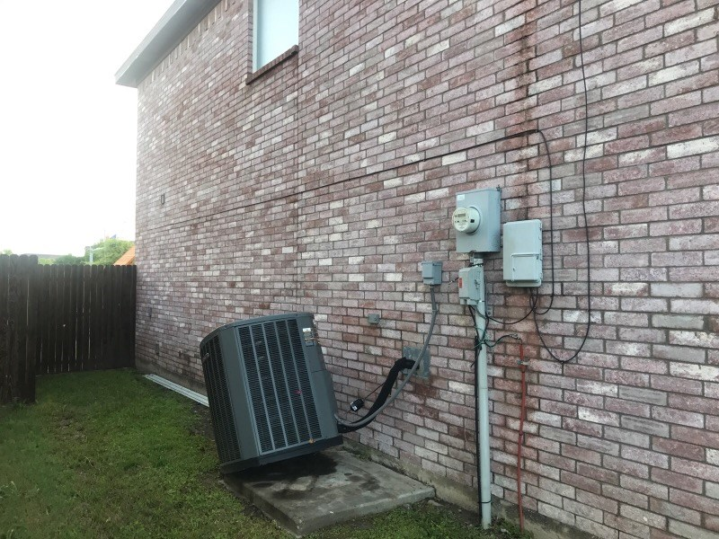 Condensing unit blown off of pad by high winds