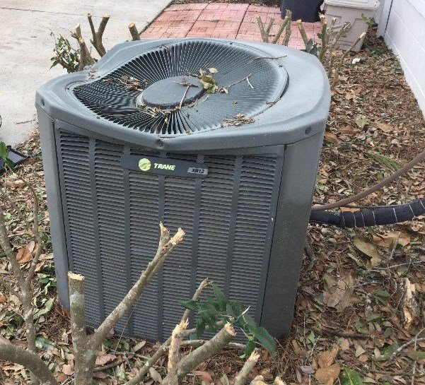 High winds send heavy objects flying and damage this condensing unit