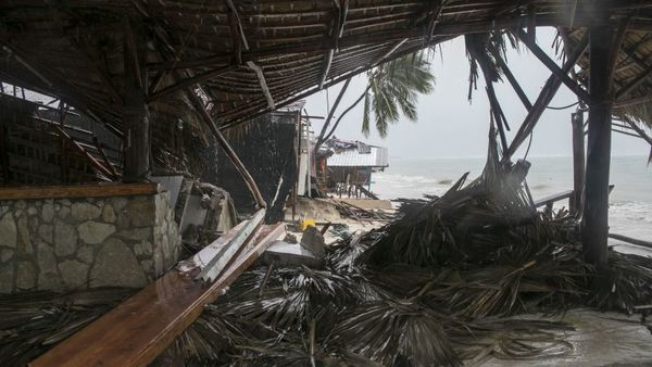 The Captain Cook restaurant lies damaged on Cofrecito Beach after the crossing of Hurricane Maria over Bavaro, Dominican Republic, Thursday, Sept. 21, 2017. Rain from the storm will continue in the Dominican Republic for the next two days according to meteorologists. (AP Photo/Tatiana Fernandez)