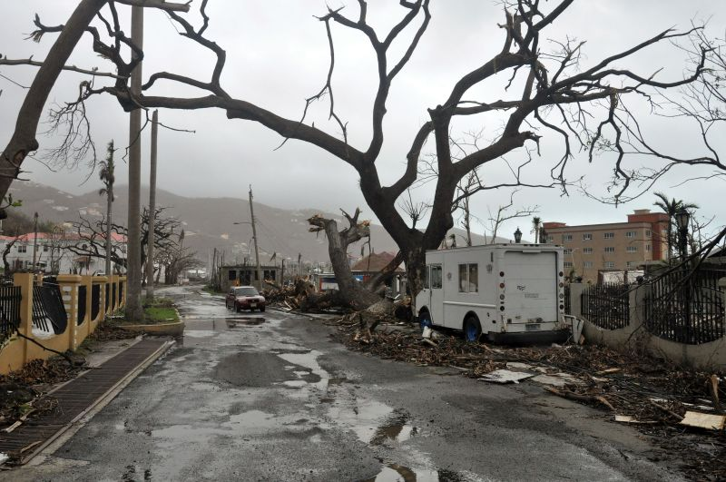Trees stand barren and debris lays on the roadside, caused by Hurricane Maria in Road Town, on the island of Tortola, in the British Virgin Islands