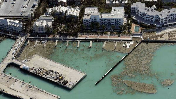 Debris from Hurricane Irma is pushed up against a sea wall in the aftermath of Hurricane Irma on Tuesday, Sept. 12, 2017, in Key West, Fla. (AP Photo/Chris O'Meara)