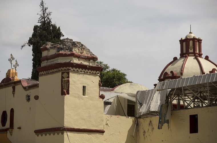 A Catholic church's bell tower is missing after the 7.1-magnitude earthquake in San Gregorio Atlapulco, Mexico, Friday, Sept. 22, 2017. Mexican officials are promising to keep up the search for survivors as rescue operations stretch into a fourth day following Tuesday's major earthquake that devastated Mexico City and nearby states. (AP Photo/Moises Castillo)
