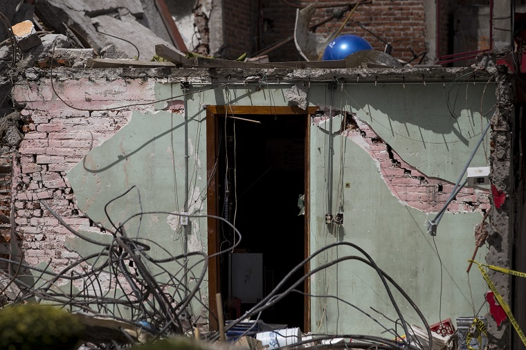 The doorway of a house collapsed by a 7.1-magnitude earthquake stands in San Gregorio Atlapulco, Mexico, Friday, Sept. 22, 2017. Authorities say 121 of the village's houses were severely damaged by the Tuesday quake and inhabitants are without water and electricity. The bell tower of the local church was toppled by the force of the quake. (AP Photo/Moises Castillo)