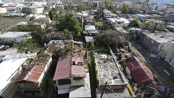 Damaged homes are seen in the El Gandul Community in Santurce after Hurricane Maria, in San Juan, Puerto Rico, Monday, Sept. 25, 2017. (AP Photo/Carlos Giusti)
