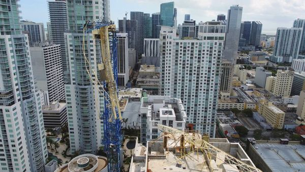 This Tuesday, Sept. 12, 2017 photo, shows a damaged crane from Hurricane Irma in Miami. Part of the crane fell in a bay-front area filled with hotels and high-rise condo and office buildings, near the AmericanAirlines Arena, where the NBA's Miami Heat play. (DroneBase via AP)