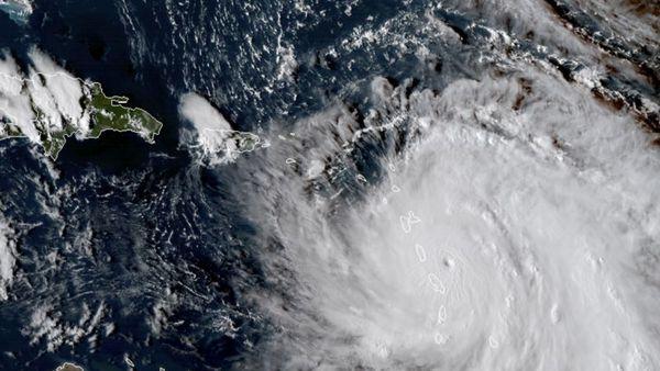 This Monday, Sept. 18, 2017, GOES East satellite image provided by NASA taken at 20:30 UTC, shows the eye of Hurricane Maria as it nears Dominica. (NASA via AP)