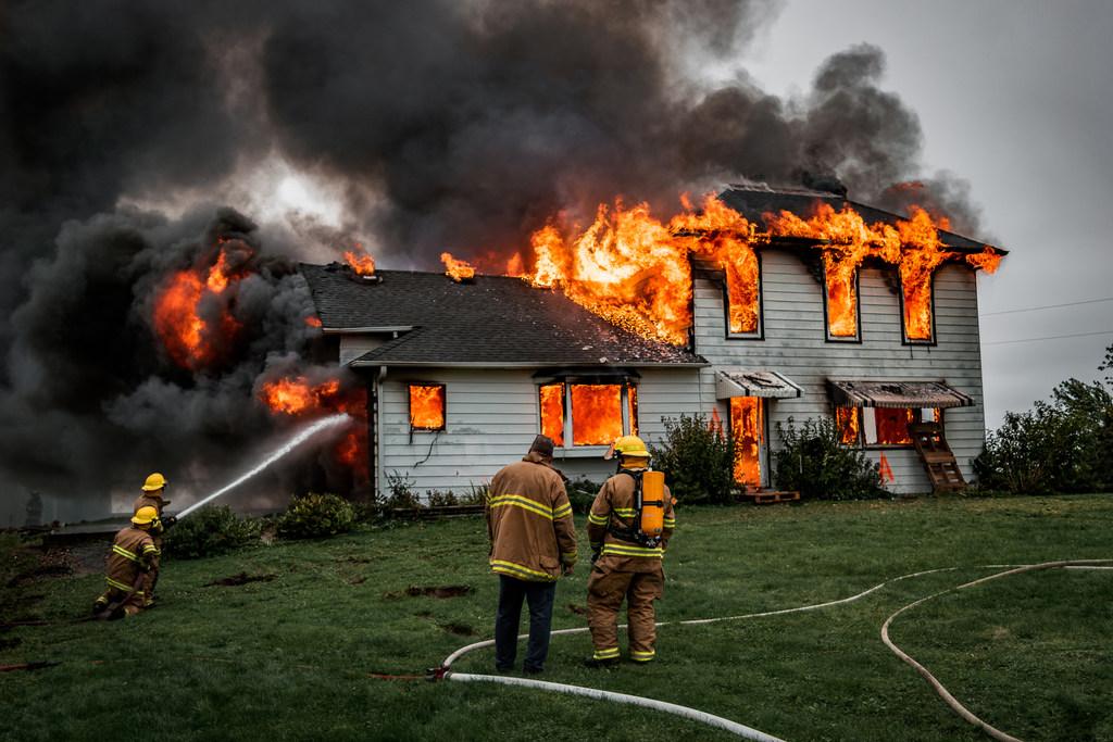 firefighters battling house fire
