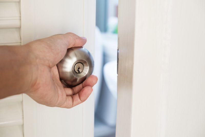 hand closing a door