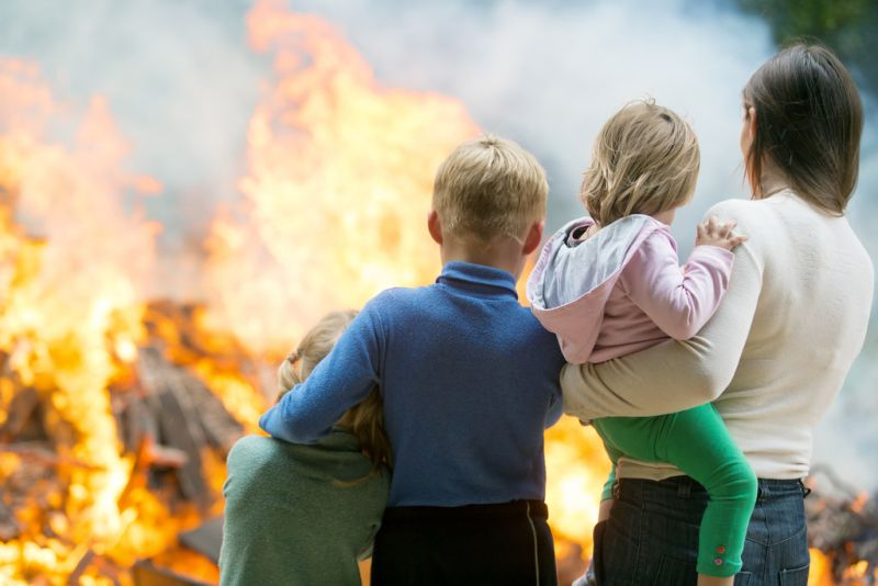 Mother and children watching home fire