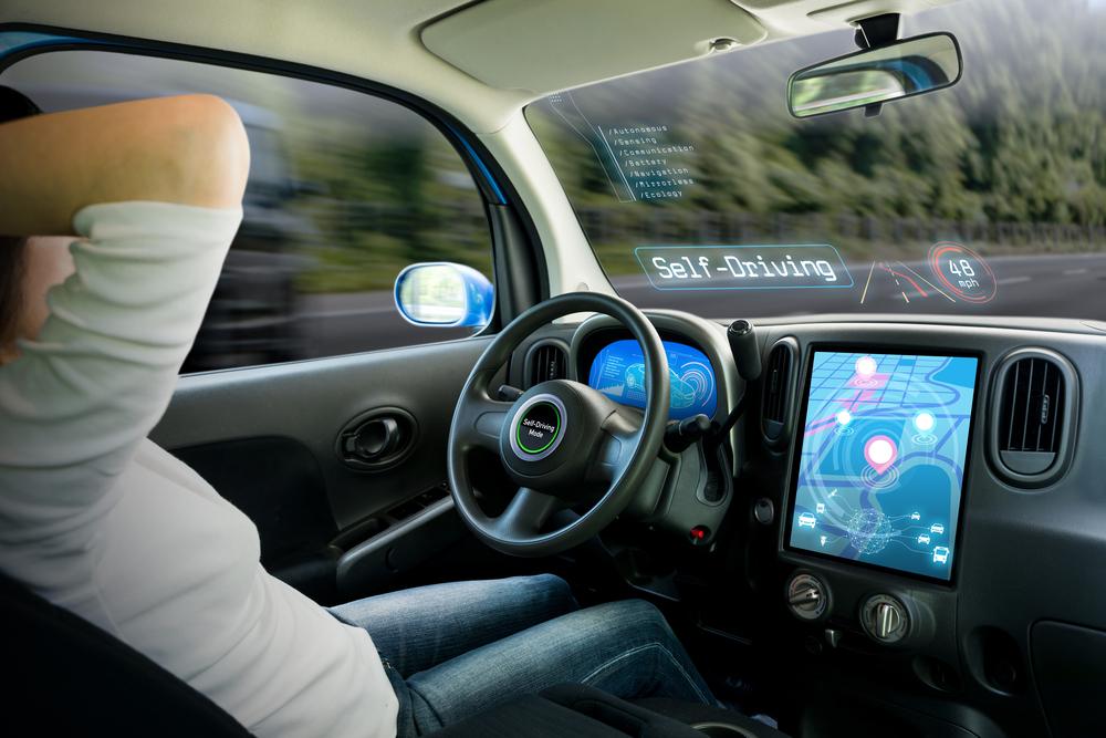 driver behind the wheel of an autonomous car