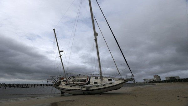 A sailboat washes ashore along the Gulf of Mexico in Biloxi, Miss., in the aftermath of Hurricane Nate, Sunday, Oct. 8, 2017. (AP Photo/Gerald Herbert)