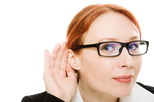 insurance agency owner listening to employees