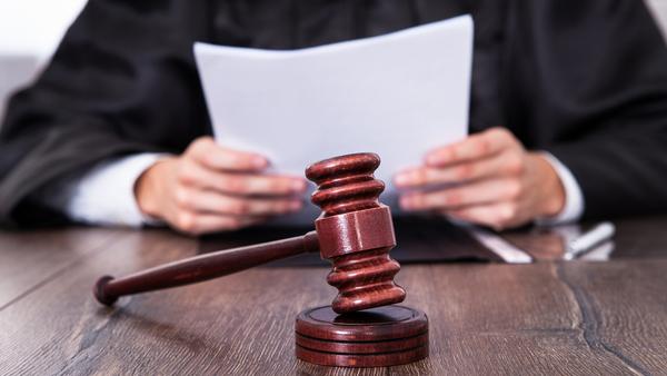 Judge in robes reading verdict