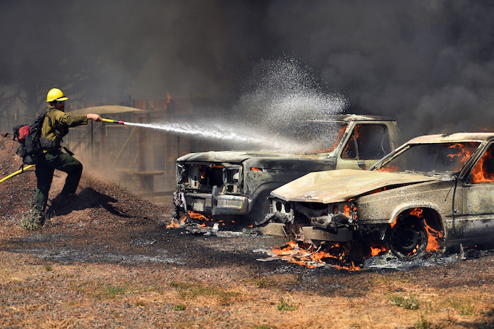 Car burning in wildfire