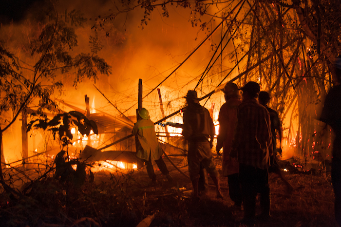 home burning wildfire