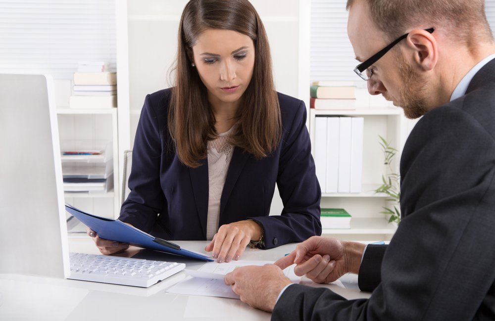 Business man and woman reviewing documents