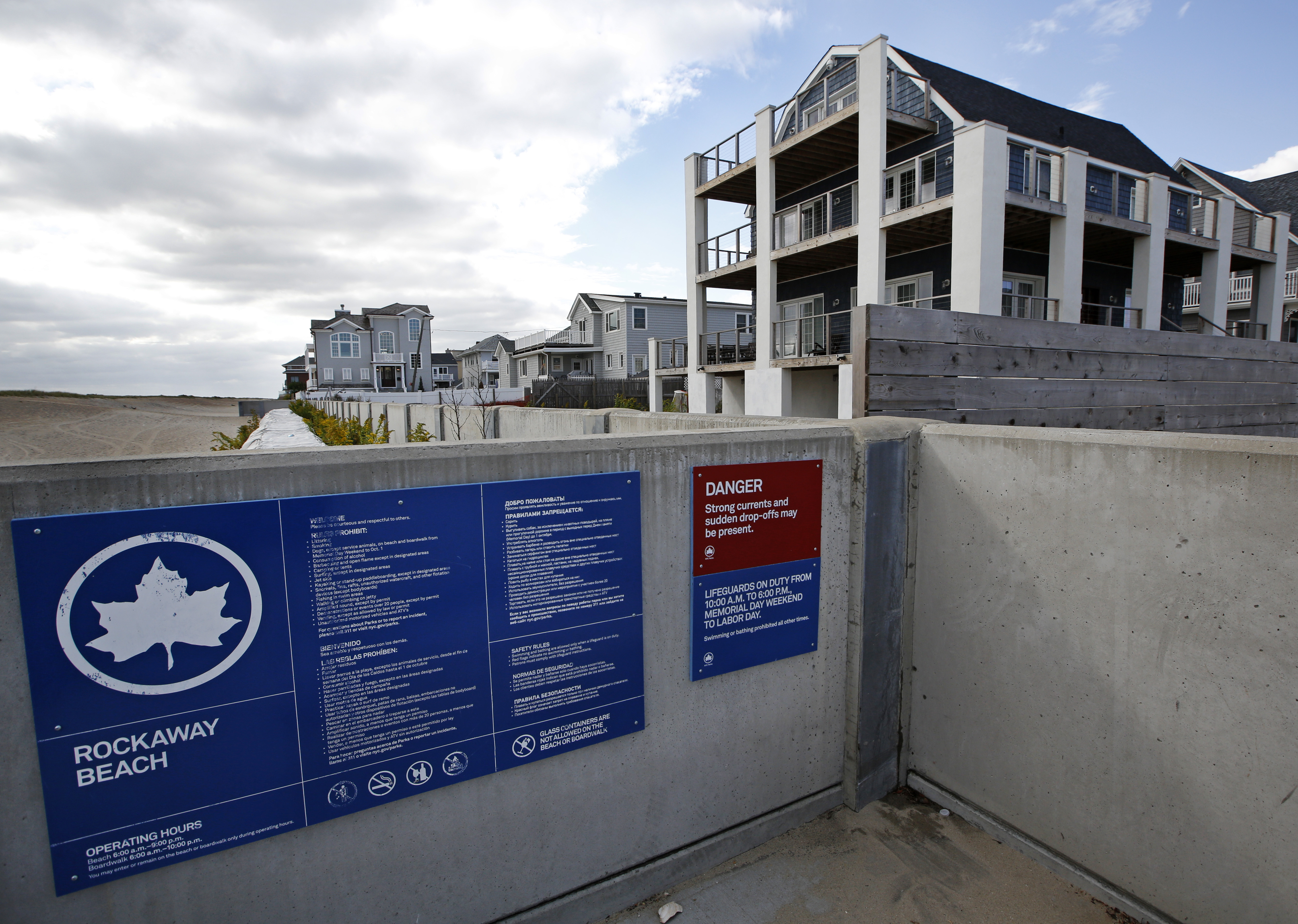 Concrete baffle wall designed to protect homes from storm surge in place in Belle Harbor NY