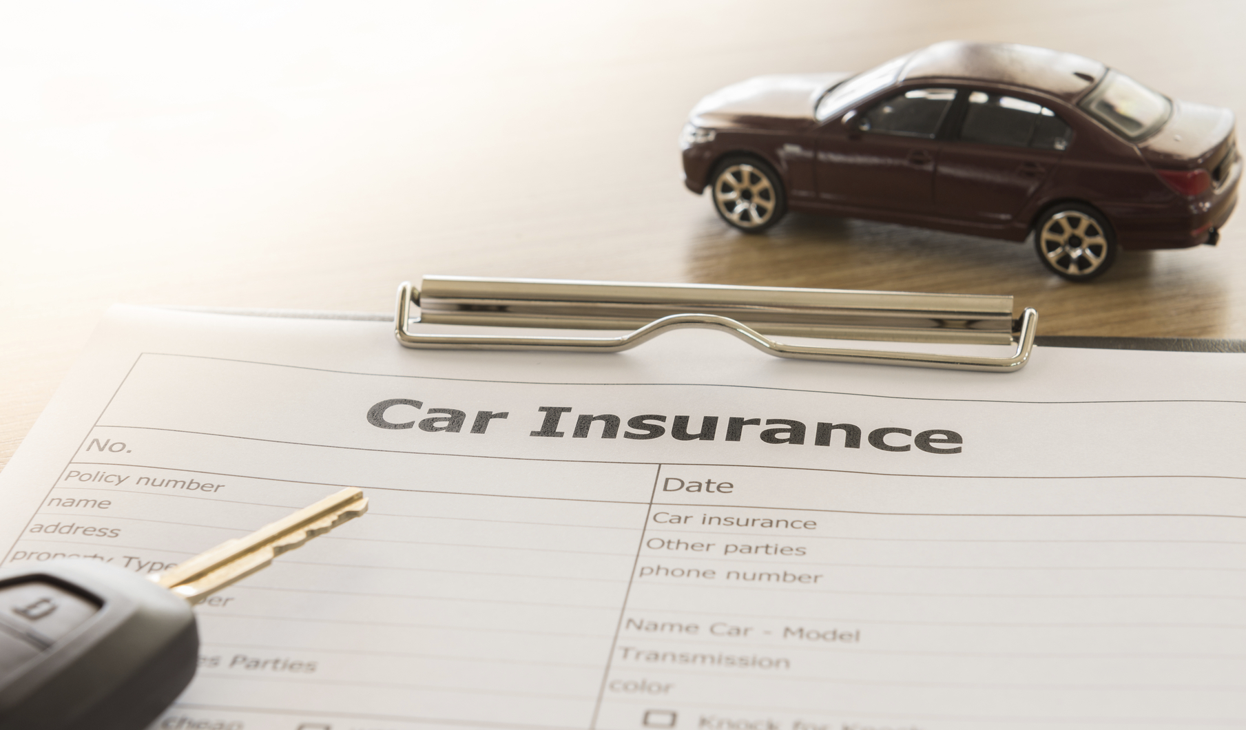 car insurance form and miniature car