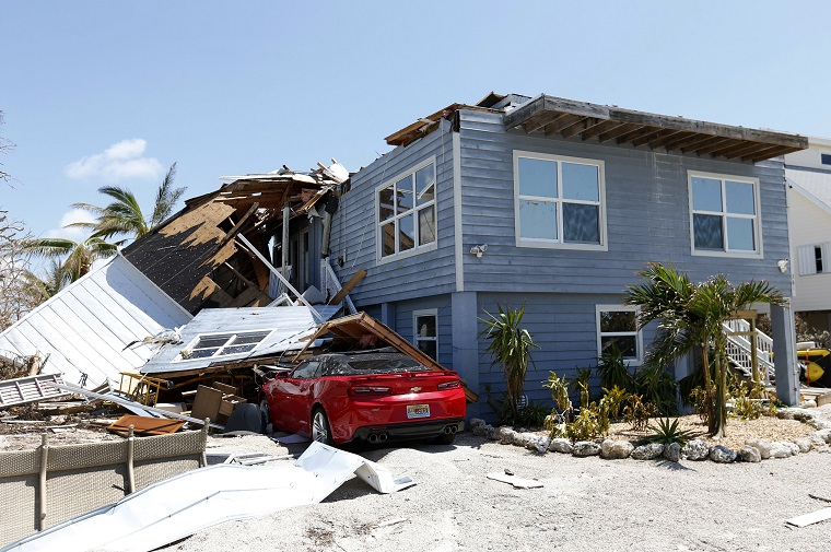 Hurricane Irma spurred many claims for roof shingles that were blown off, especially on corners. (AP Photo/Wilfredo Lee)