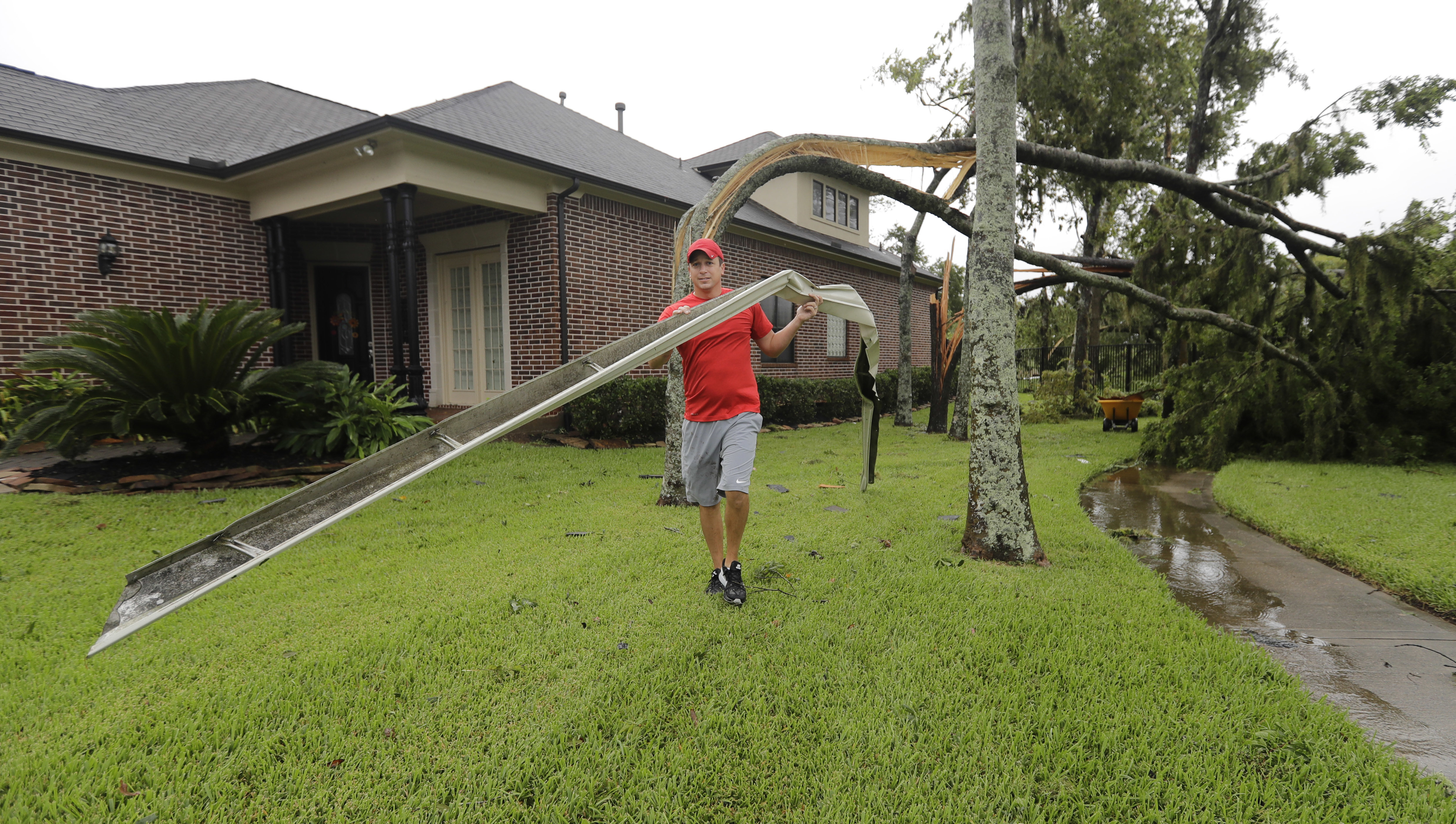 Making sure gutters and downspouts are clear is one step that can prevent damage during a severe weather event. This resident's property in Missouri City, Texas sustained damage during Hurricane Harvey. (AP Photo/David J. Phillip)