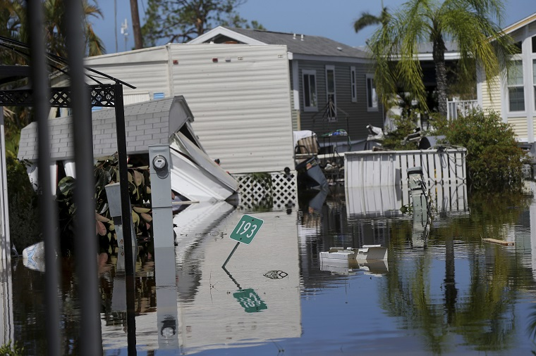 Due to Irma, many basement drains became fountains. (AP Photo/Gerald Herbert)