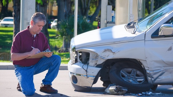 Auto adjusters should ask policyholders for information to ensure they have all of the facts related to an accident. (Photo: Shutterstock)
