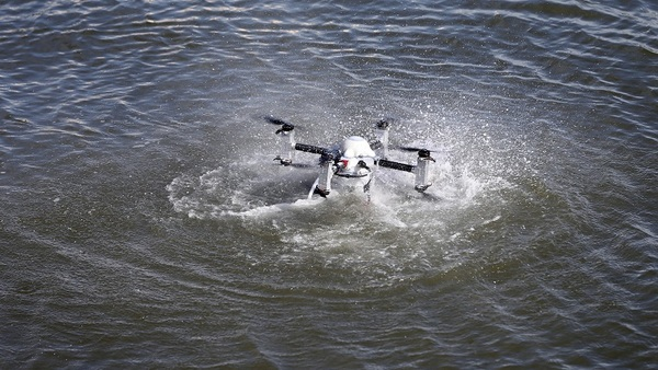 A broad range of industries now seeks insurance for commercial drone use. The one is capable of working underwater. (AP Photo/Mel Evans)