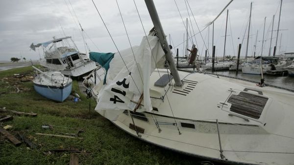 Boats damaged by Hurricane Harvey are are washed up on shore Saturday, Aug. 26, 2017, in Port Lavaca, Texas. (AP Photo/Charlie Riedel)
