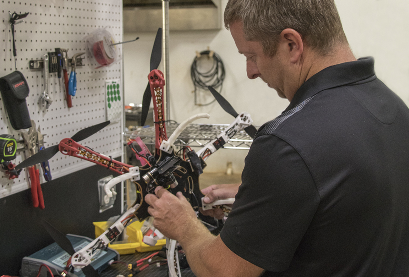 Man repairing a broken drone