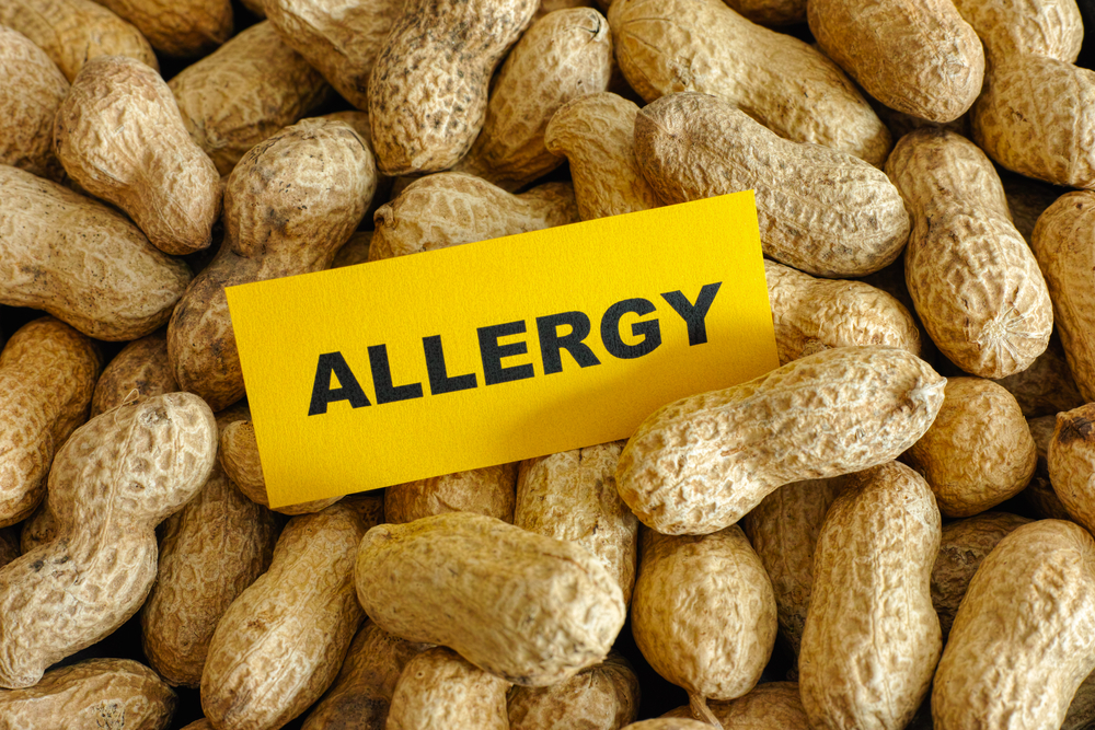 allergy sign in a pile of peanuts