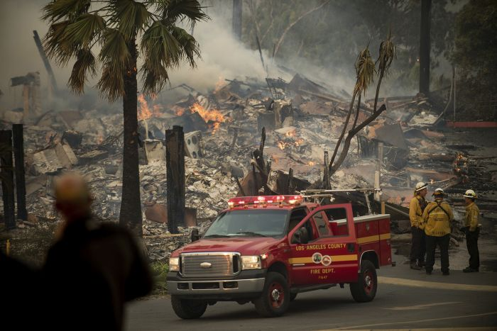 An apartment complex burns as a wildfire rages in Ventura, Calif