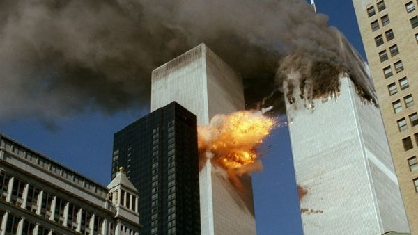 FILE- In this September 11, 2001 file photo, smoke pours off World Trade Center Tower 1 as flames explode from Tower 2 as it is struck by American Airlines Flight 175, after terrorists crashed hijacked airliners into the buildings. (AP Photo/Chao Soi Cheong)
