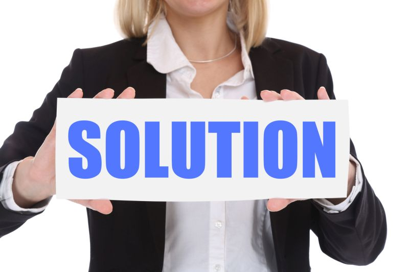 Woman holding up word, Solution