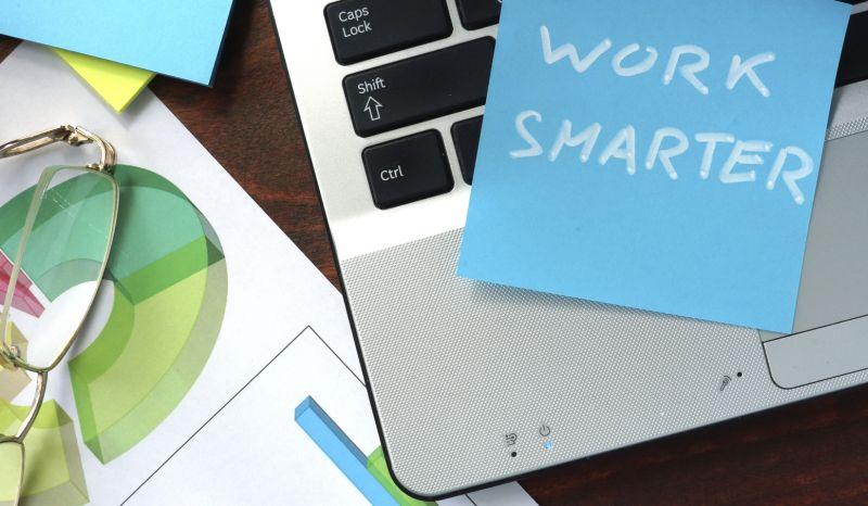 Work smarter sticky note on laptop