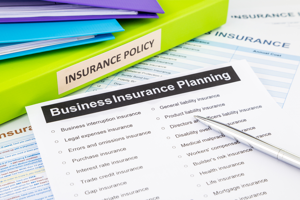 insurance policies on table