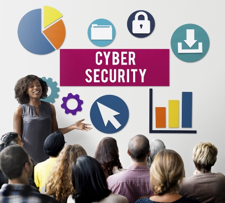 African-American woman leading employee training on cyber security
