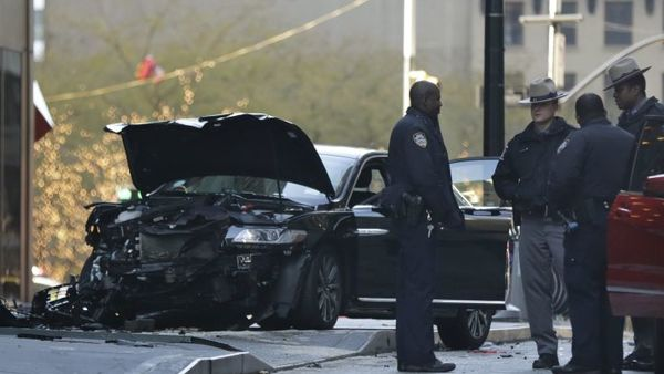 Police gather at the scene of an accident near Broadway and Liberty Street in New York on Thursday, Dec. 7, 2017. Police say six people were hurt in the accident involving three vehicles just blocks from the World Trade Center in Lower Manhattan. (AP Photo/Peter Morgan)