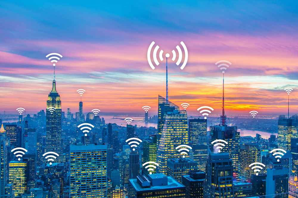 wi-fi emanating from various buildings in a cityscape