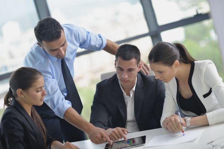 Millennial employee receiving manager feedback