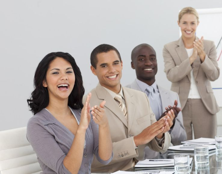 Millennial employees that are clapping