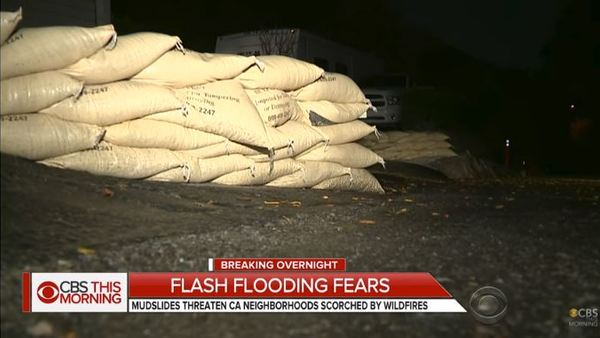 Some areas have been hit with waist-deep mudflows and downed trees and power lines. (Image: YouTube)