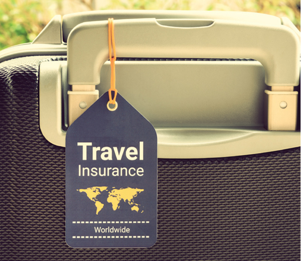 Suitcase with a travel insurance tag